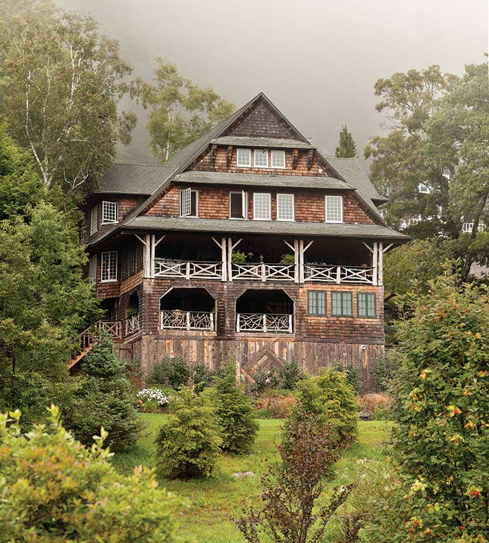 Built at the very end of the Victorian era, the bark-on-log and shingle house is in the rustic style of the Adirondack Great Camps. It nestles in amidst the misty Catskill Mountains.