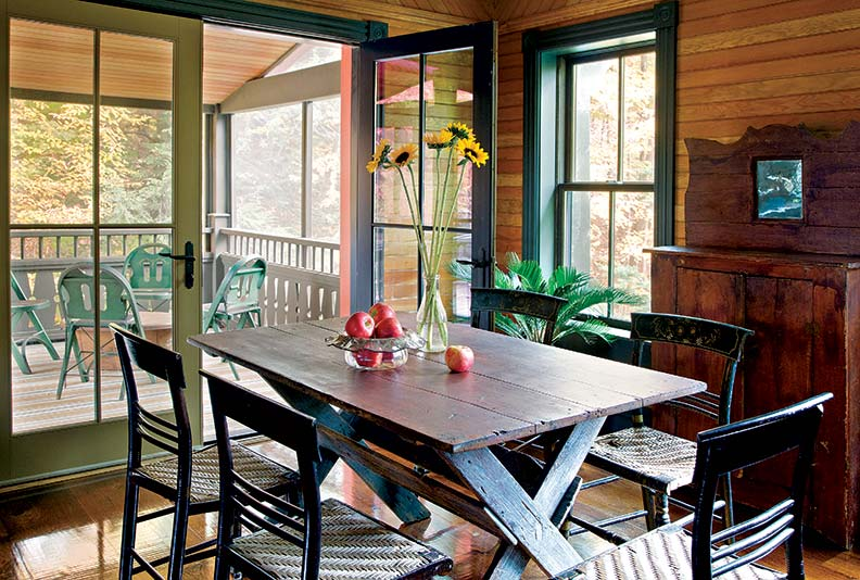 The couple's informal dining room opens onto the second-floor screened porch.