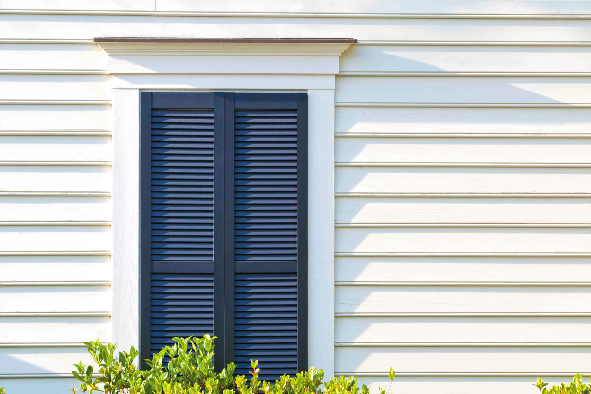 A good set of shutters not only looks authentic in materials and scale (like these from Aeratis), but also closes tightly to protect the window.