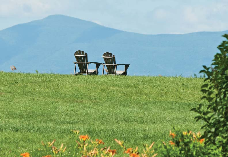 Against the backdrop of the Catskill Mountains, Adirondack chairs create an iconic silhouette.