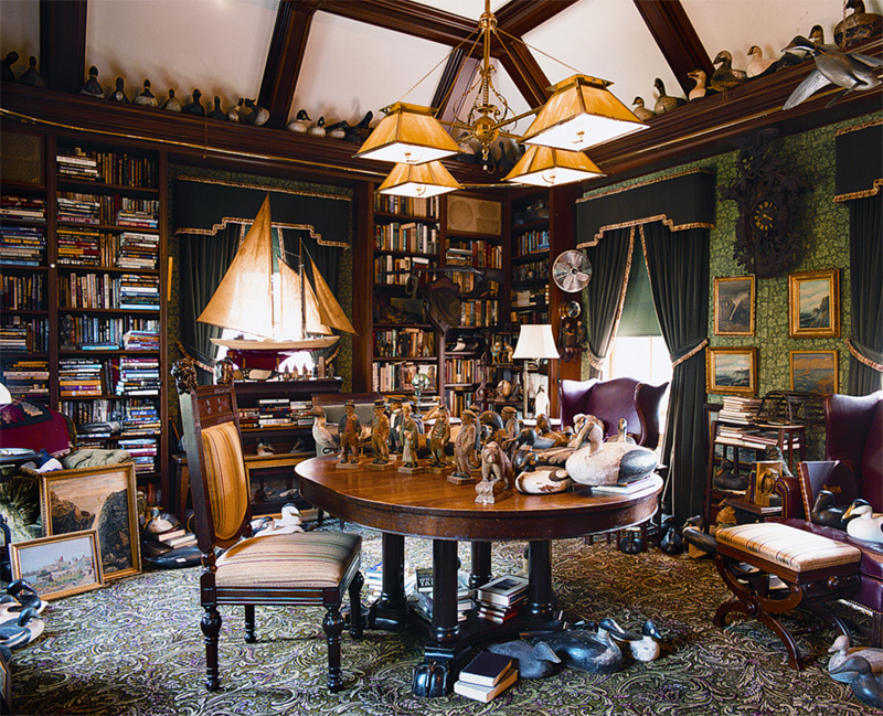 In a turn-of-thecentury Shingle/Colonial Revival house, the master's library has an old English feel and is crammed with paintings, collections, maritime memorabilia, a rifle—and books.