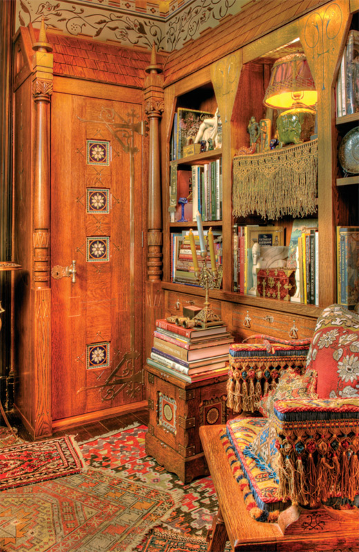 Inspired by the Modern Gothic furniture of Kimball & Cabus, this bookcase was built into a miniscule New York City apartment to create an English Aesthetic library. It's made of oak and outfitted with all of the Gothic bells and whistles: a shingled roof (which lifts up for much-appreciated storage), ornate nickel-plated strapwork, and Pugin tiles set into the cabinet doors.