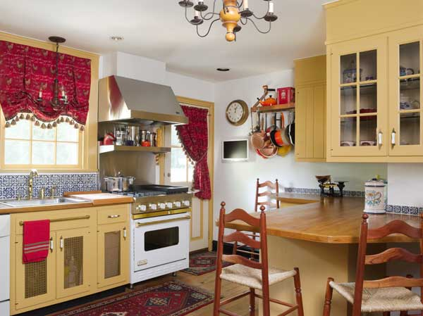 Alluding to the early 20th century, the kitchen was built of salvaged wood and painted in Philadelphia gold.