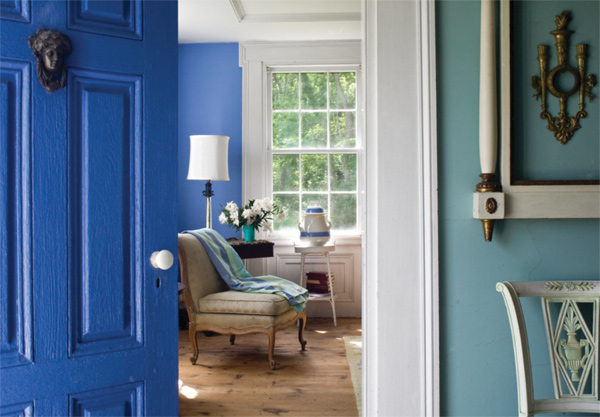 An aqua stair hall complements the deep blue of the parlor, which was inspired by classical Wedgwood china.