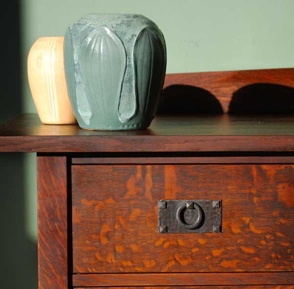 An oak dresser from Caledonia Studios reveals beautiful rays and flecks, as well as a deep patina hand-applied by the artist.