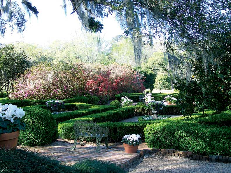 Low rows of boxwood and flowering plants create a formal garden called a parterre, a design inspired by the gardens of Europe.