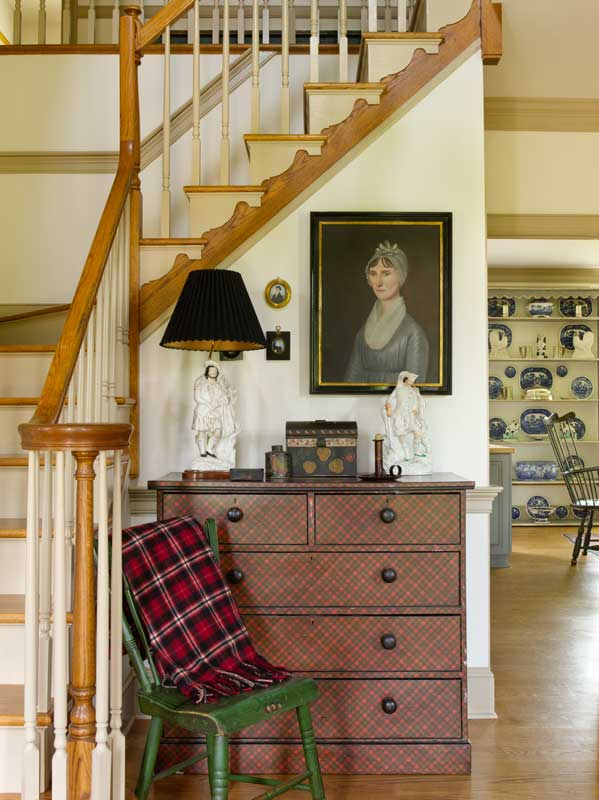 Antiques and reproductions mingle in well-edited rooms.