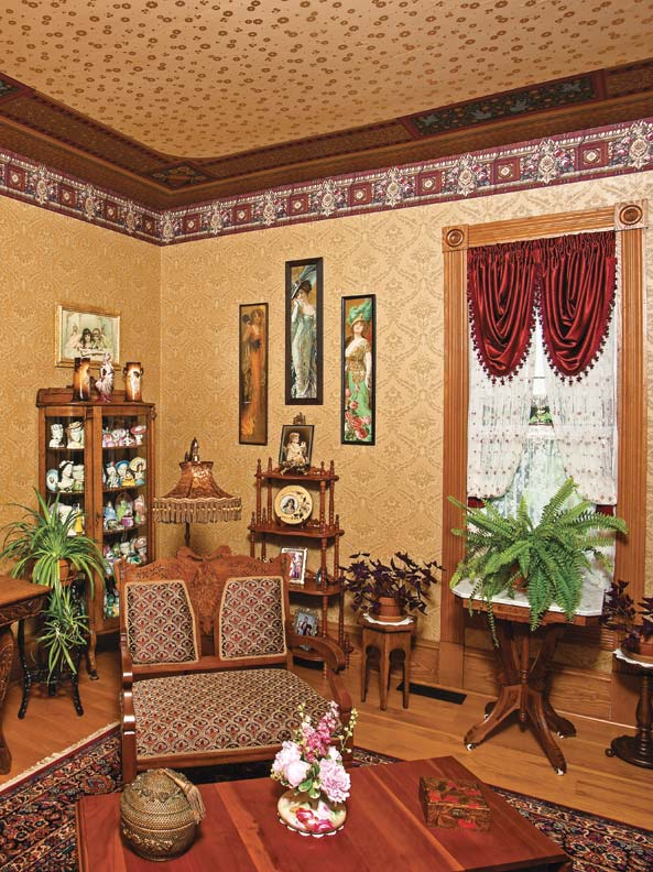 Antiques in the gold parlor include a whatnot shelf.