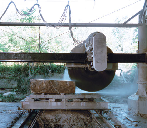"A 76"" diamond circular saw slices through a block of Texas limestone."