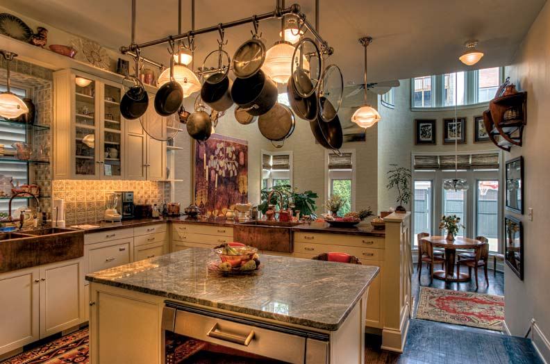 kitchen with holophane-style lights and farmhouse sinks