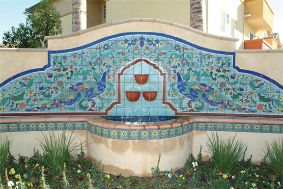 Fountains were a popular application for art tile—especially in the West. A mural of vivid peacocks strutting amidst flora shows California-style art tiles at their bright, earthy best.