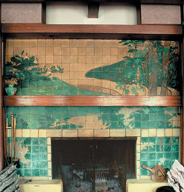 The tiles for this dining room fireplace in the Gamble House (1908) are known to be the work of Encaustic Tiling of Zanesville, Ohio. Charles Greene designed the mosaic insets using glass bits and iridescent ceramic shards.