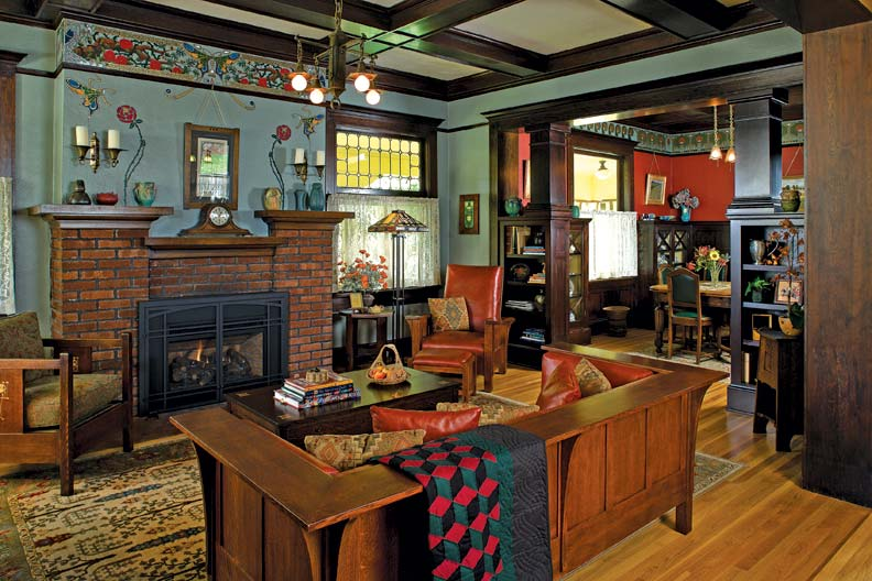 A restored bungalow in Portland, Oregon (embellished with friezes by artist C.J. Hurley), boasts classic A&C seating: a Morris chair and matching ottoman, and an even-arm settle.