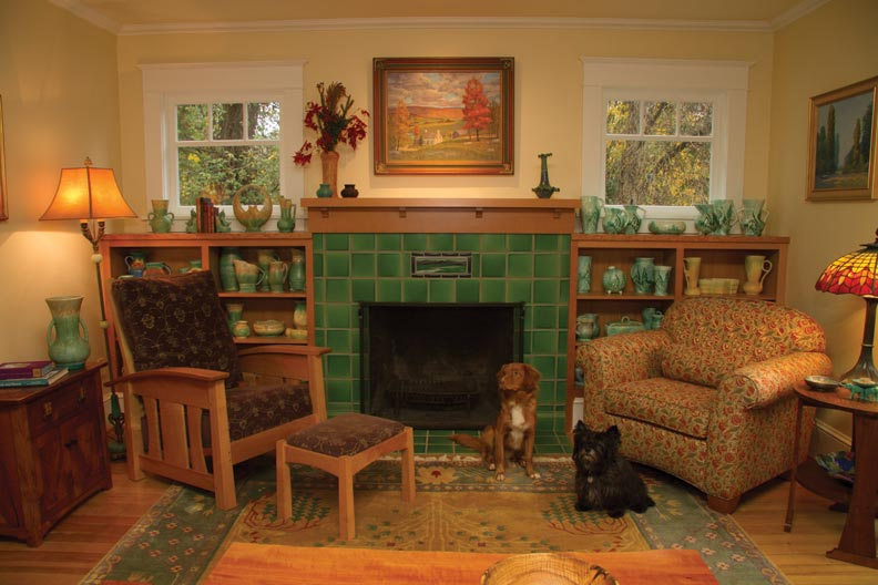 Green Motawi tiles and a new mantel and bookshelves made of salvaged fir replaced the subpar arrangement that the owners inherited with the house.