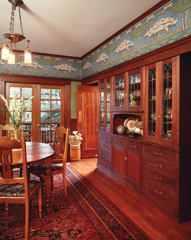 In an Arts & Crafts home with an abundance of woodwork, a bold scenic frieze acts as a transition from wall to ceiling.