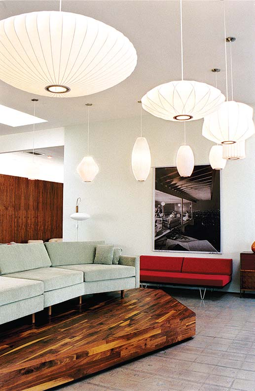 A squadron of George Nelson bubble lamps appears to be flying in formation across a modern-day Modernica showroom.