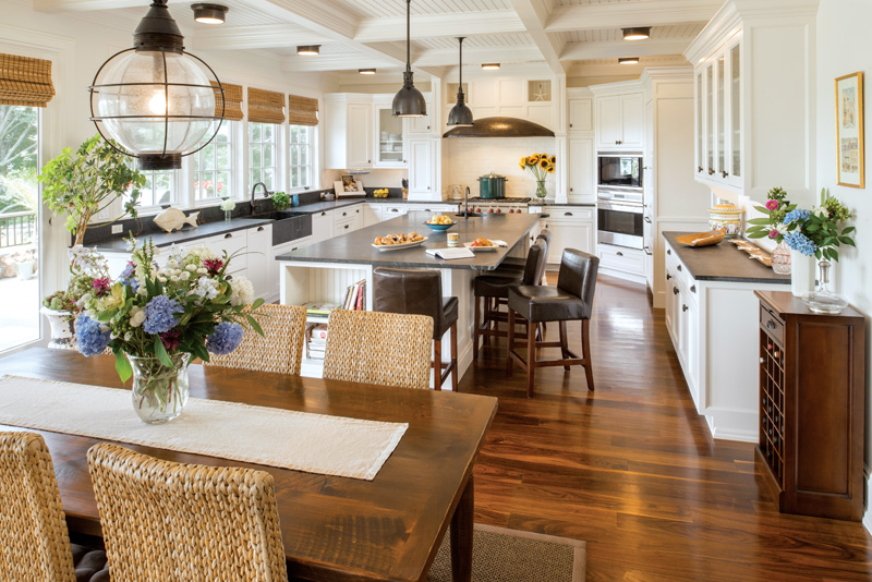The central island is the heart of the kitchen, with food preparation at the far end and entertaining in the foreground. Soapstone, a material traditionally used for kitchen sinks, is used for all of the countertop areas.