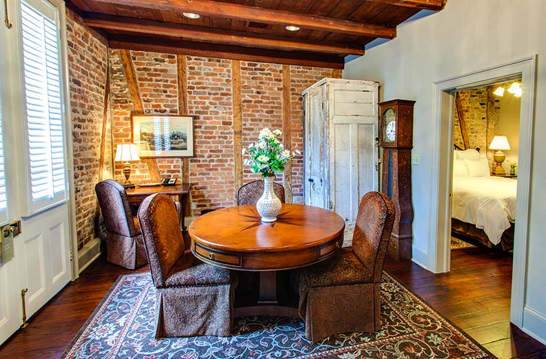 Original beams and brick walls are highlighted in Cottage 1, where John James Audubon spent time.