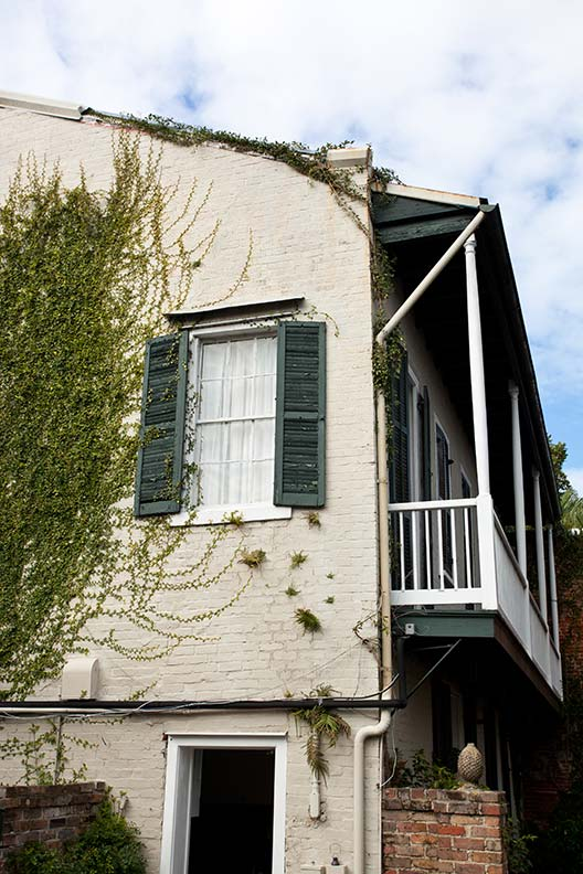The restoration maintained the cottages' brick façades and charming shutters.