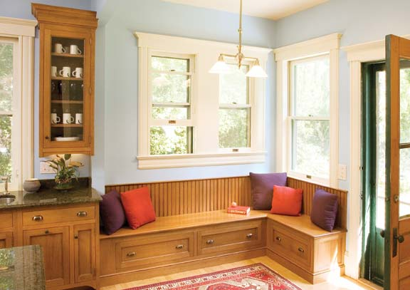 This banquette from Crown Point Cabinetry doubles as an impromptu mudroom, the perfect spot to put on coats, boots, and galoshes.