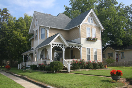 This circa 1889 house—Design No. 40—in Knoxville's Edgewood area, is typical of Barber's High Victorian designs.
