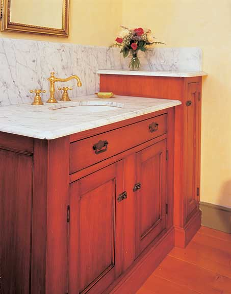 Marble, fir, and reproduction ardware make a new cabinet by Kennebec look like an original.