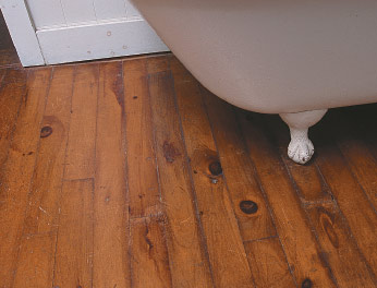 As in many old houses, this strip floor in a bathroom is a later addition, so historical accuracy is much less an issue than the practicality of polyurethane in a wet environment.