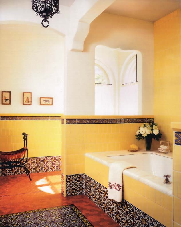 Tiled-in bathtubs, like the marble-topped example in this sunny restored bathroom, evolved to make cleaning easier by eliminating dust bunnies hiding beneath raised clawfoot tubs.