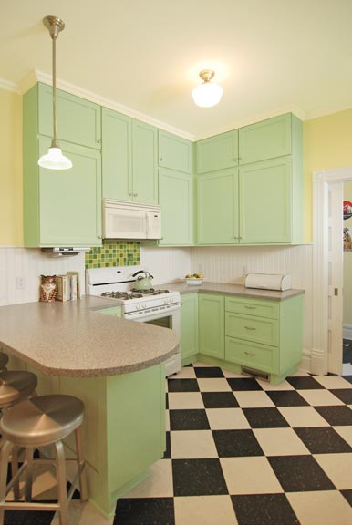 Beadboard was a budget-minded compromise that places an era-appropriate material around the kitchen without the expense of tiling all the walls.