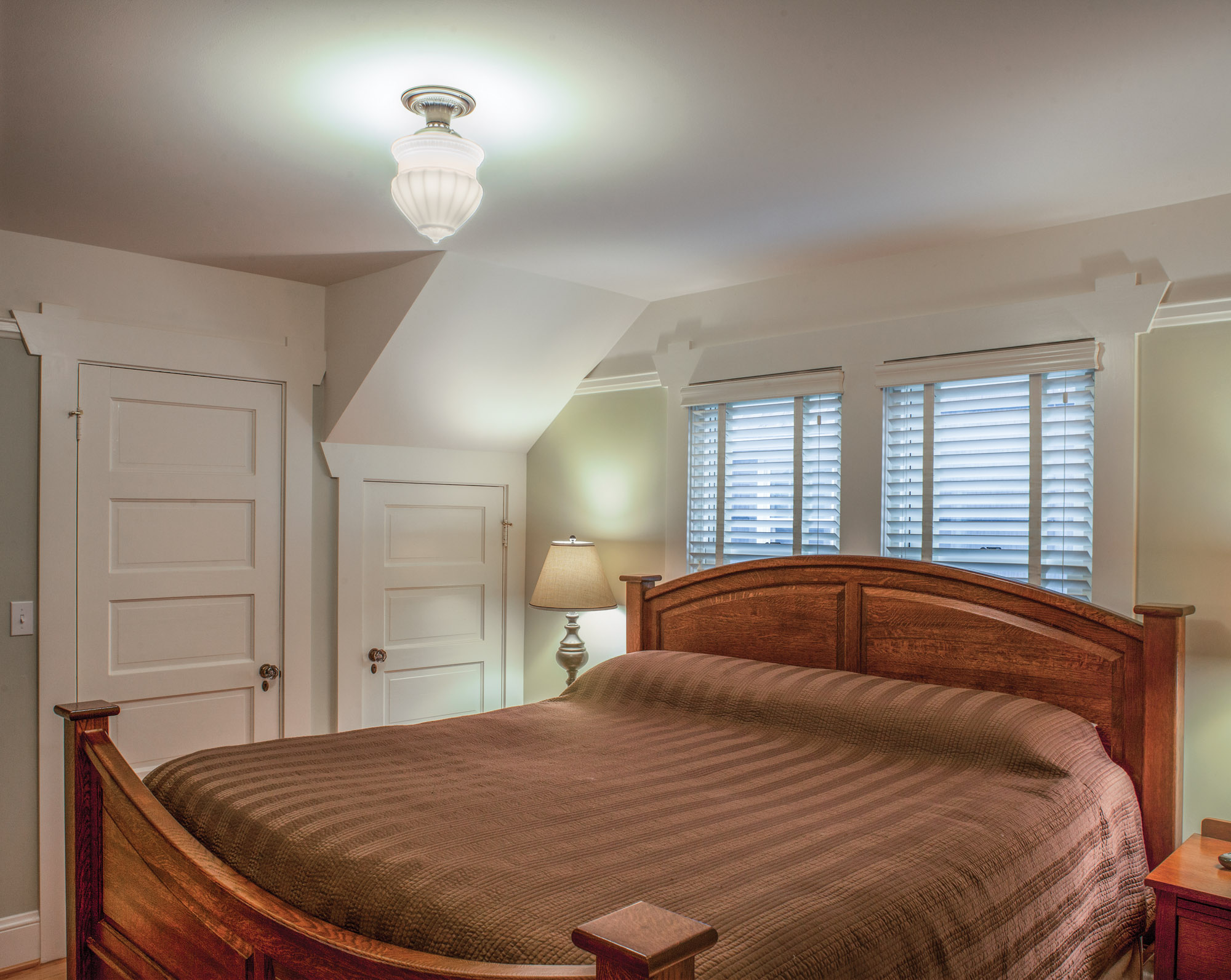 Now with a closet and direct access to the restored bathroom, the master bedroom sits conveniently on the first floor.