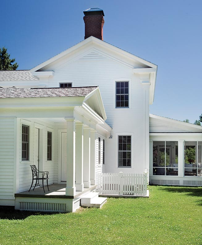 Architect Sandra Vitzthum designed this farmhouse addition using traditional clapboards, square column supports for the farmer's porch, and wood roof shingles.