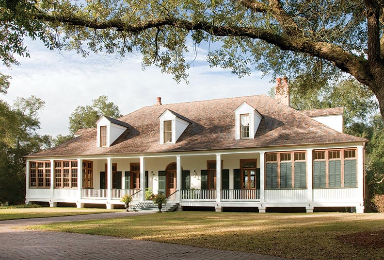 Exterior shutters keep this coastal house protected from both heat and storms.