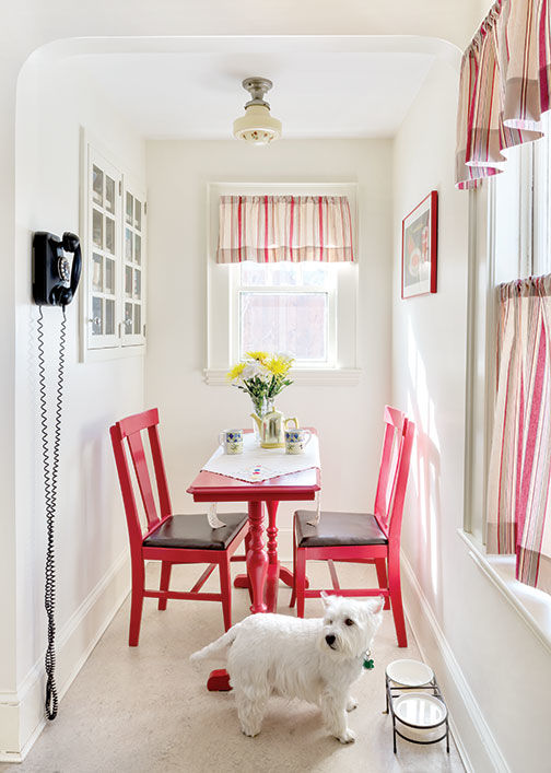 A red table (found at a flea market) brightens the breakfast nook.