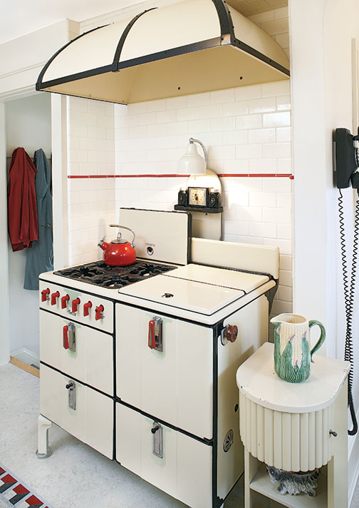 A vintage stove occupies a tiled alcove in this 1930s kitchen