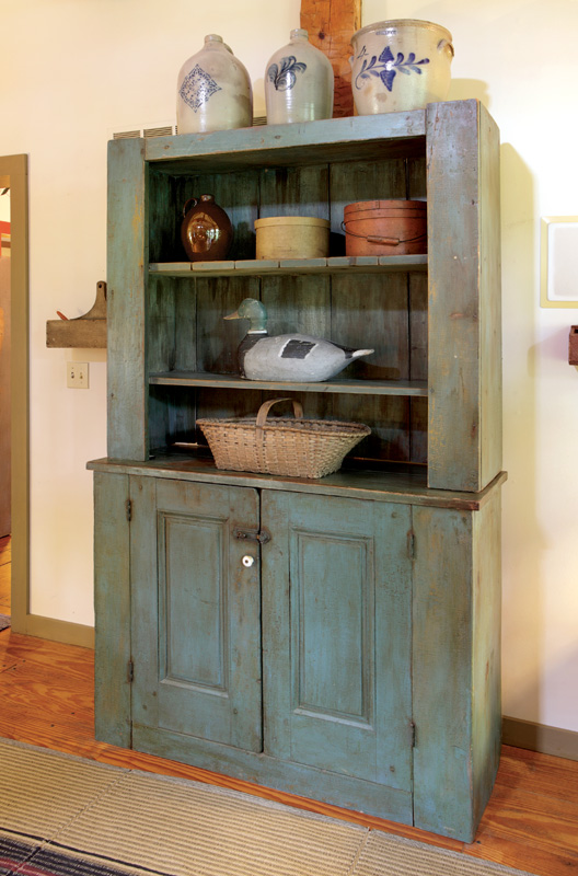 Blue hutch in the family room.