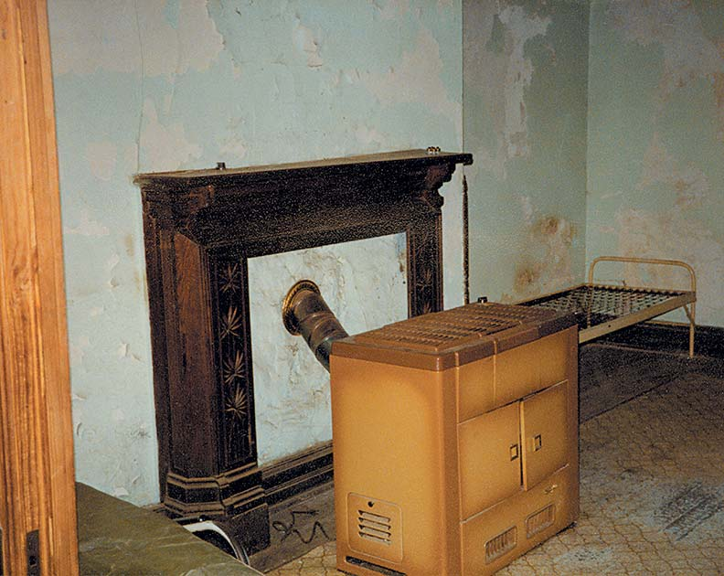 Bob chiseled plaster out of the house's fireplaces, some of which were serving wood stoves.