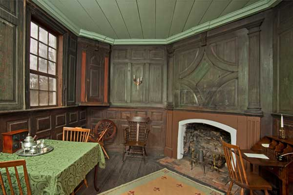 Bold woodwork extends to the small parlor.