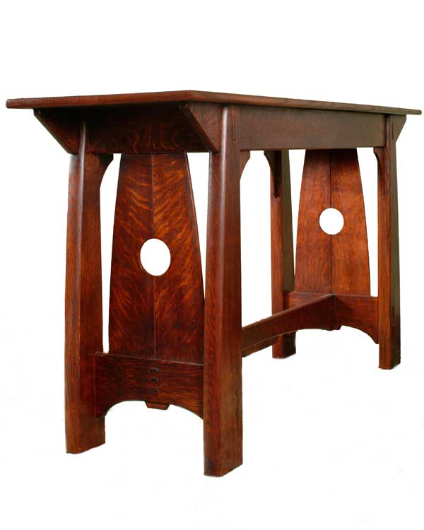 Book-matched end pieces cut from the same flitch open to show the radiating grain in this side table from Cold River Furniture.