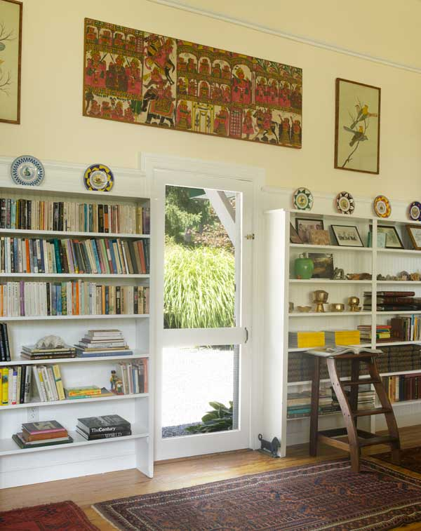 Bookcases remain from the building's days as a summer colony's library. White trim and warm yellow plaster brighten the once-dreary rooms.