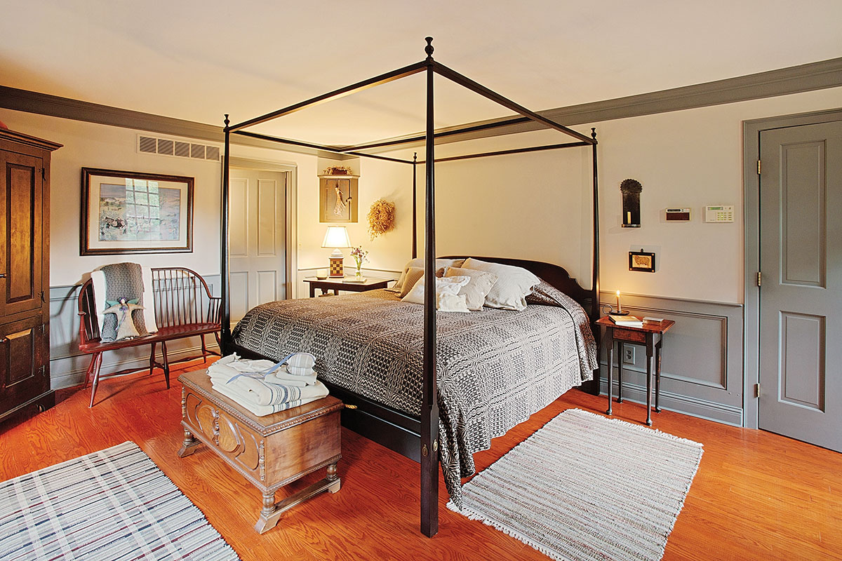 The master bedroom features simple Georgian woodwork and an 18th-century ambiance, albeit with modern comfort.