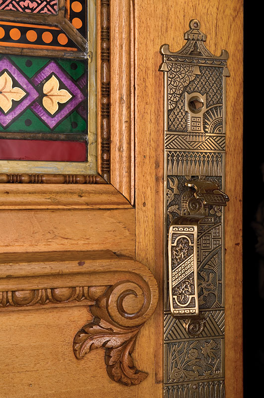 Entry door, glass panel, and 1870s hardware all were salvaged. (Photo credit: William Wright)