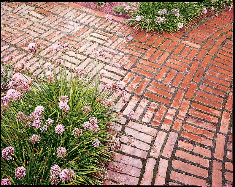 Brick laid in patterns paves garden walkways both linear and circular. (Photo: Mick Hales)