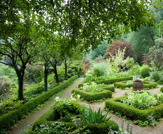 Brick paving adds even more formality to the gray garden, a parterre that features gray and white plantings and overlooks the walled garden.