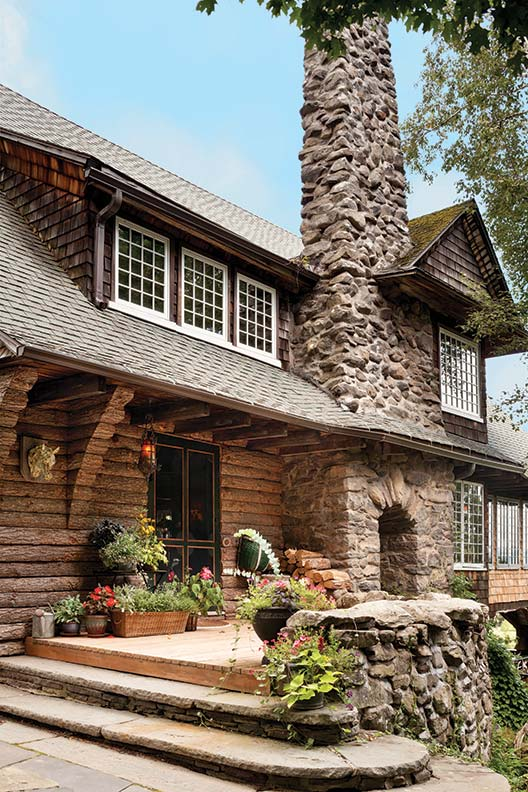 Broad eaves and a massive fieldstone chimney give the front entrance welcoming appeal.