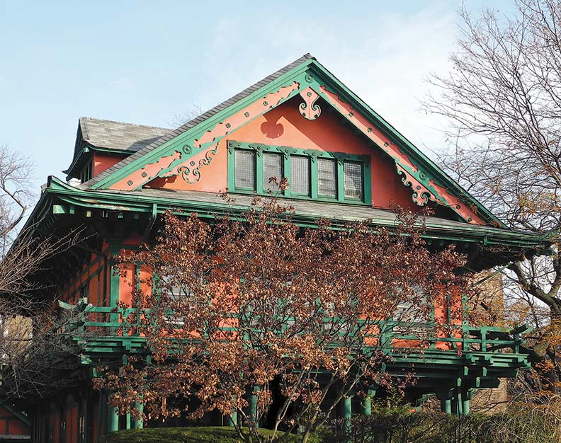 The house is an eye-catching oriental expression with upturned gables and carvings; second-story balconies with curved railings are reminiscent of a Shinto temple.