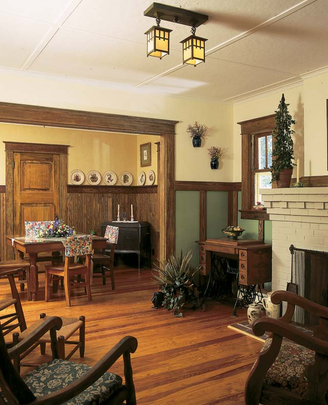 The tongue-and-groove wainscot in the dining room and the burlap wainscot in the living room are period enhancements.