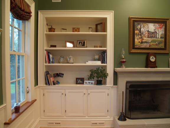 Built-in bookcases with storage beneath are trimmed in historic molding patterns.