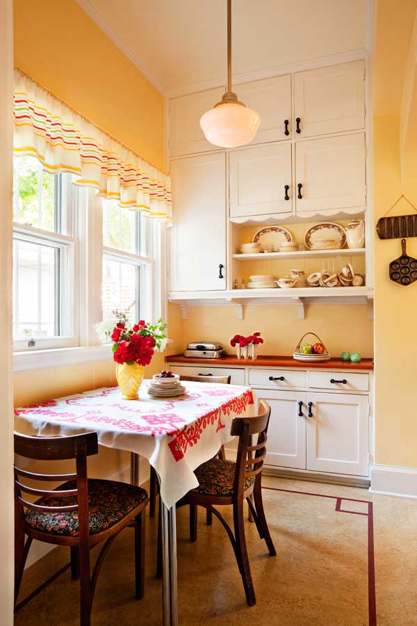 Built-in cabinets in the breakfast nook have scalloped trim that probably dates to the 1920s.