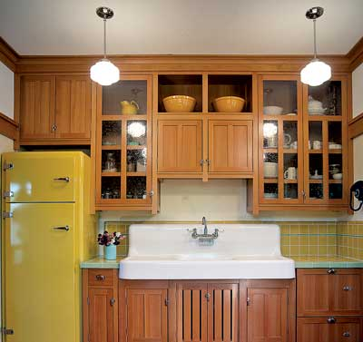 The cubbies above the cabinets in Scott and Renee Davis' bungalow kitchen were specially designed to hold Renee's two golden-hued Bauer bowls.