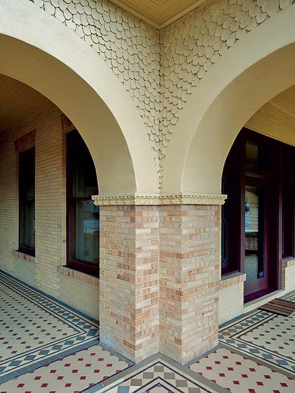 It took Martin Diaz, Sr., a plaster craftsman with three decades of experience, six weeks to develop a technique for re-creating the unusual scalloped texture of the original exterior walls on the house's first-floor porch.